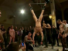 A horny gay gets tortured and fucked hard in group BDSM scene