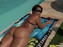 Bootilicious Brazilian angel is riding a cock in condom