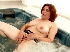 Oversized mature BBW drills her bushy cunt with baseball batt in bathtub