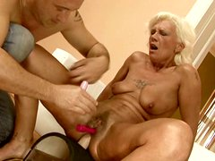 Kinky grannie rides sex machine and gets her pussy stuffed