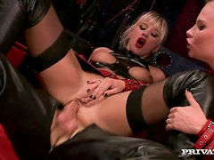 Two blonde bitches in leather costumes share a dude's cock
