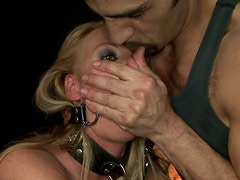 Curvy gagged blondie is tied up and gets her rounded butt smacked