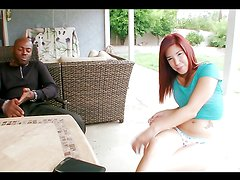 Sexy redhead cums all over a black monster cock as she's fucked