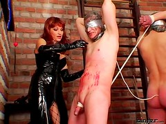 Two latex mistresses abuse him