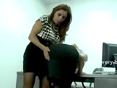 Two women spank each other big asses while being fucked hard with a strapon