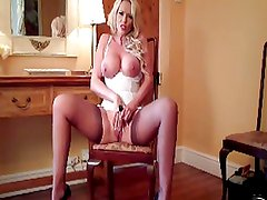British slut Lucy plays with herself in flesh stockings