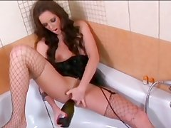 Brunette with a bottle in pussy and ass