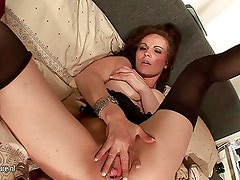 Horny MILF loves playing with herself on bed