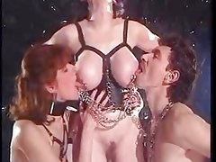 Mature in leather with two slaves (F & M)