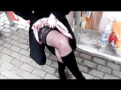 Lady in pink dress and black fishnet stockings