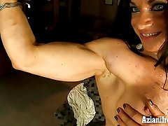 Ripped Bodybuilder plays with her huge clit