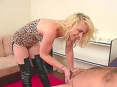 Thigh high leather boots girl kicks him