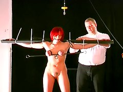 Redhead tied up and ass paddled