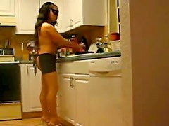 Nearly nude wife cooks in kitchen