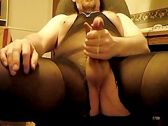 Bear in nylon body suit pulls on balls and jerks big cock