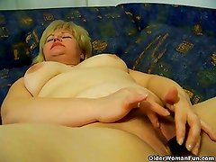 Chubby mature housewife rubs her swollen pussy