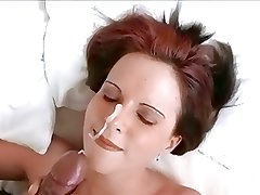 Big black cock facial on red-head