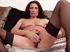 Mature Tracey spreads in black stockings