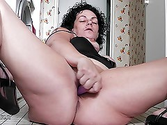 Horny mature slut granny playing all through her house