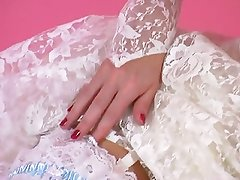 An Erotic Tease 001-A Brunette Bride Strips Out of Her Dress