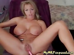 Busty shaved MILF with vibrator playing with her muff