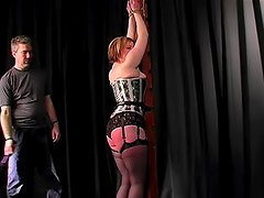 Flogging ass of a hot chick in corset