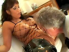 Busty babe in boots makes him lick ass