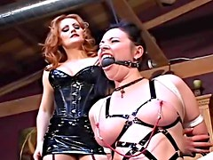 Dominatrix abuses submissives in dugeon