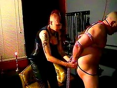 Dominatrix with mohawk abuses him