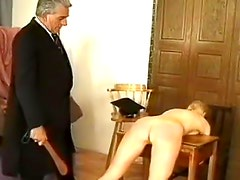Bent over a desk and caned hard
