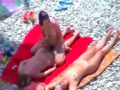 Girl on girl play at beach