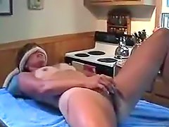 Blindfolded amateur with shiny dildo plays
