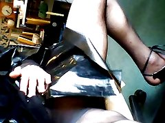 04) Crossdresser in Plastic Mac and Tights