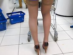 Girl in blue dress and tan stockings in supermarket 2