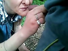 Cum on face to blond mature slut in the public park