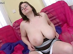 Busty British mom shows off great rack and loves her dildo