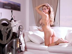 Pretty Erika Marcato shows her hot body lying on a sofa