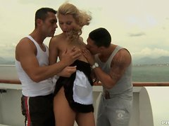 Kristi Lust sucks two pricks on a ship and enjoys awesome DP