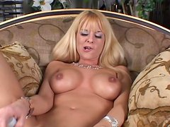 Curvaceous blonde girls masturbate in lying on a sofa