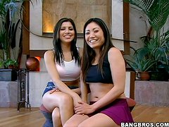Busty brunettes Kaiya and Sativa Rose share a cock indoors