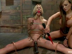 Pretty blonde gets toyed with a strap-on an elec dildo in bondage vid