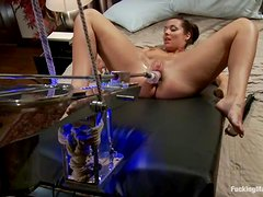 Busty Beverly Hills gets her tight ass drilled by a machine
