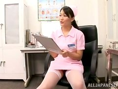 Provocative Japanese Nurse Giving Upskirt Views of Her Panties