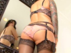 Heart-stopping bombshell Tera Patrick is posing in front of the mirror in tempting lingerie