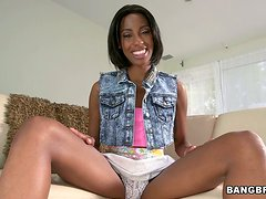 Adriana Malao oils her black pussy and favours herself with fingering