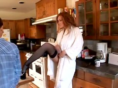 Morgan Reigns gives a footjob and a blowjob in the kitchen