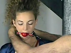 Curly hair bondage muse has fun in dungeon