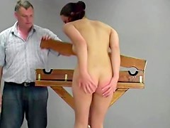 See her scream and cry as her ass is spanked