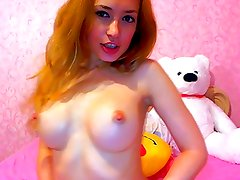hot redhead with perfect breast on the cam, must see -