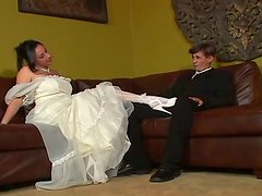 Lustful lady in white dress is about to serve two studs